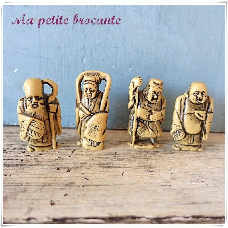 Lot de quatre figurines asiatiques publicitaires Jacquet
