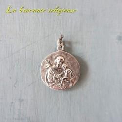 Médaille de Saint-Joseph portant l'enfant Jésus en argent