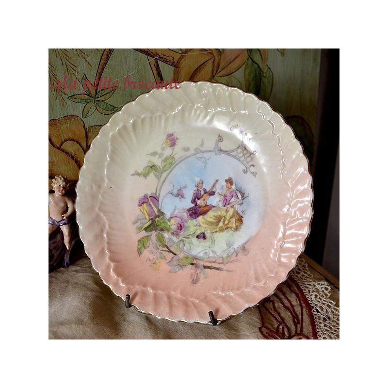 Belle assiette ancienne en porcelaine de Limoges signée JC